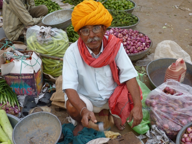 An old man in the market selling his wares