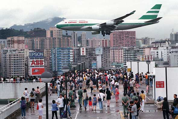 A plane on approach to Kai Tak airport