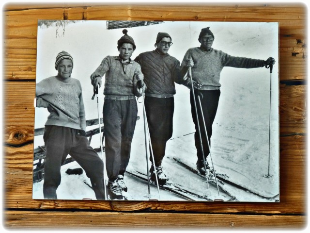Ski characters from the past on the walls of the rifugio.