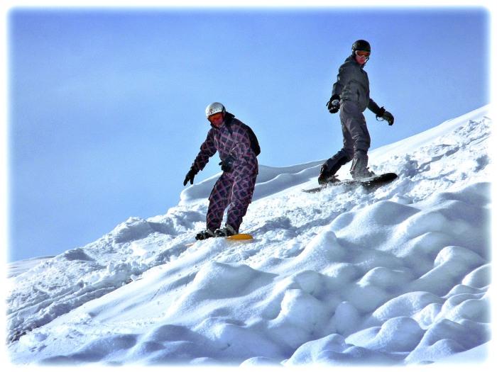 Off-Piste Snowboarders in the Valandrea Vetta ski area.