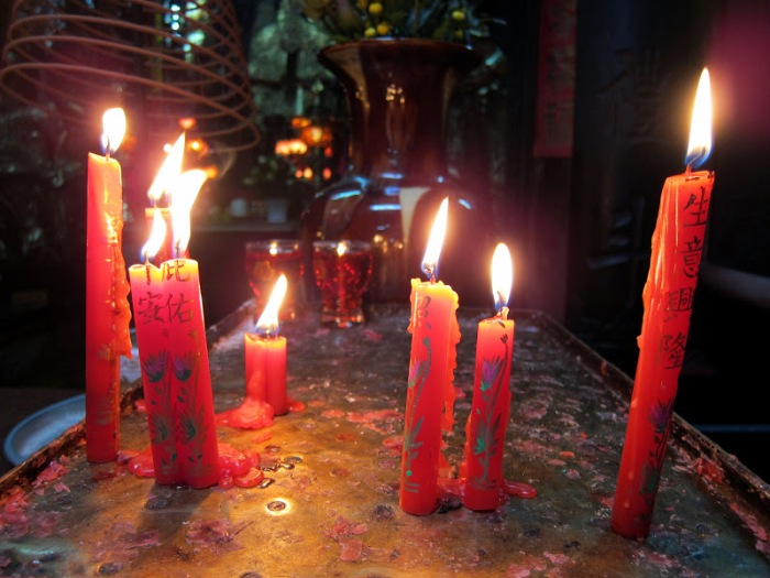 Candles lit inside the temple