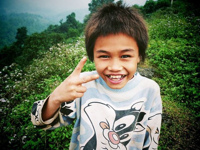 Vietnamese boy from the minority Van Kieu hill peoples near Laos