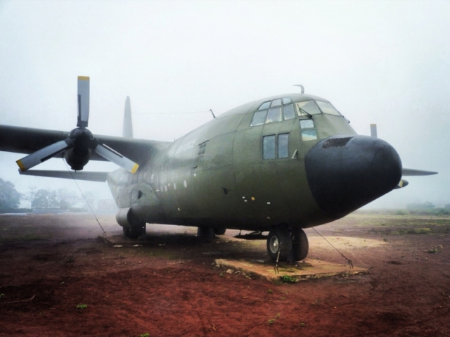 An abandoned Hercules Transport aircraft left sitting on the airstrip at Khe Sanh