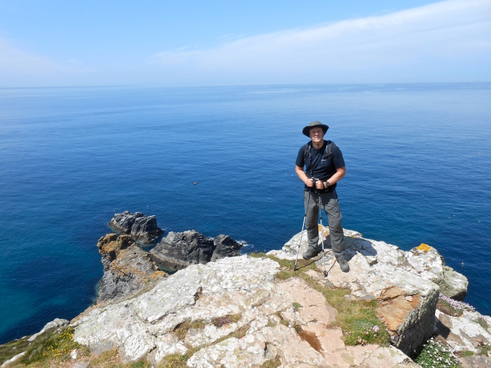 Looking suitably adventurous against the backdrop of blue seas and rocky clifftops along the way