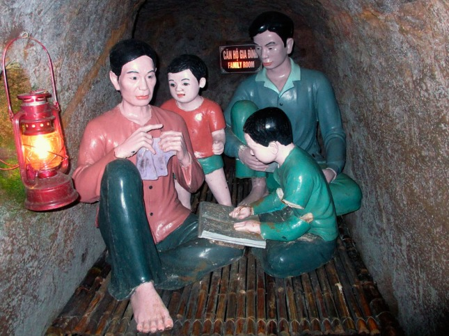 Depiction of family sheltering in the Vinh-Moc Tunnels