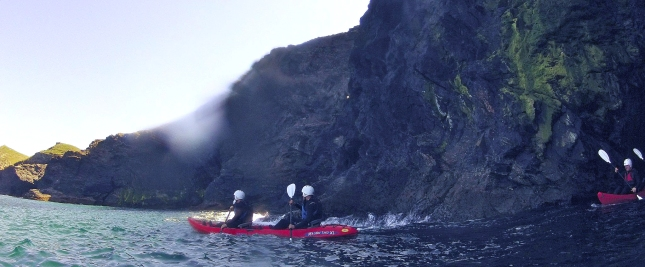 Paddling out of a sea-cave into open sea