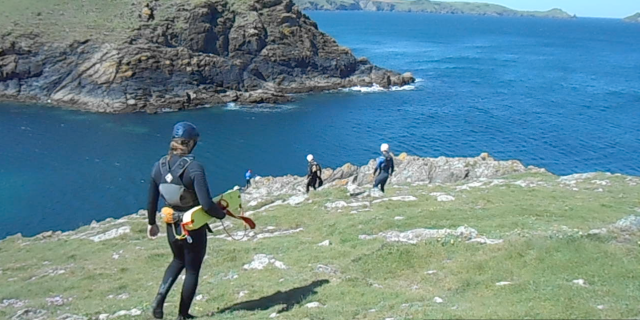 Taking the route down to the cliffs for a spot of Coasteering