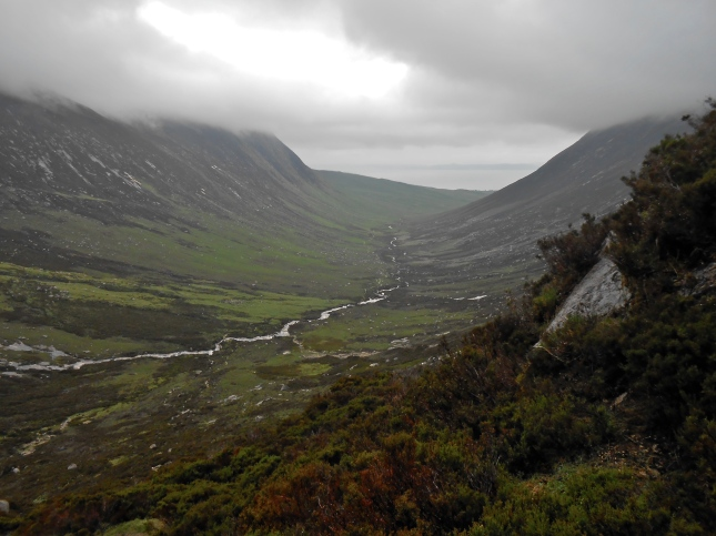 Peering down into Glen Sannox while climbing the trail path to The Saddle
