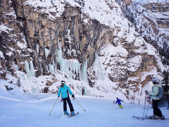 Skiing beneath one of the many frozen waterfalls along The Hidden Valley