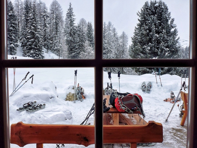 A snowy scene through a window of the Runch Hut