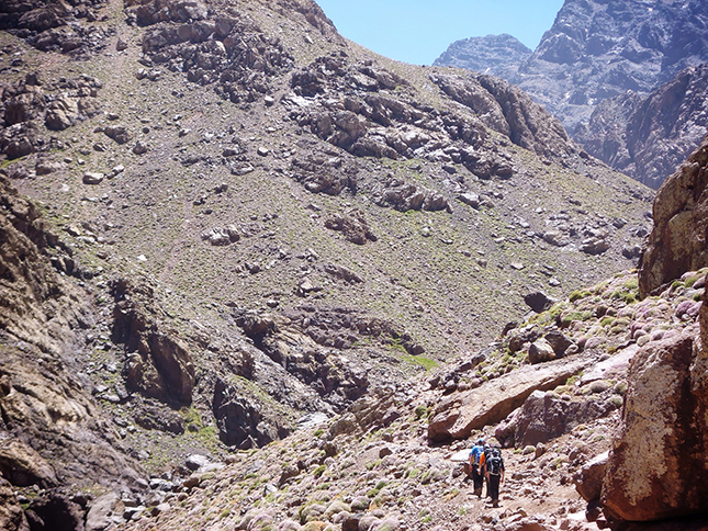 Entering the High Atlas Mountains dwarfed by the massive peaks