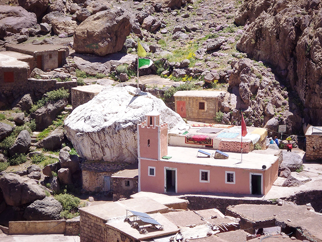 The shrine at Sidi Chamharouch and the white painted boulder