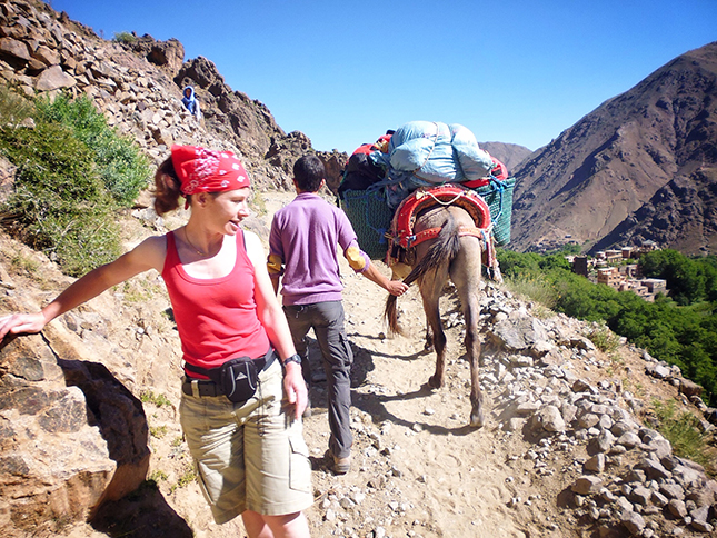 Emma ducks out of the way of our muleteer as he and his mule pass by on the narrow trail path