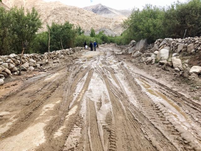 Muddy landslide across the valley road